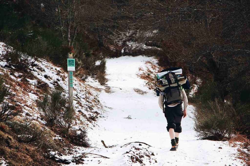 Man trekking in snow