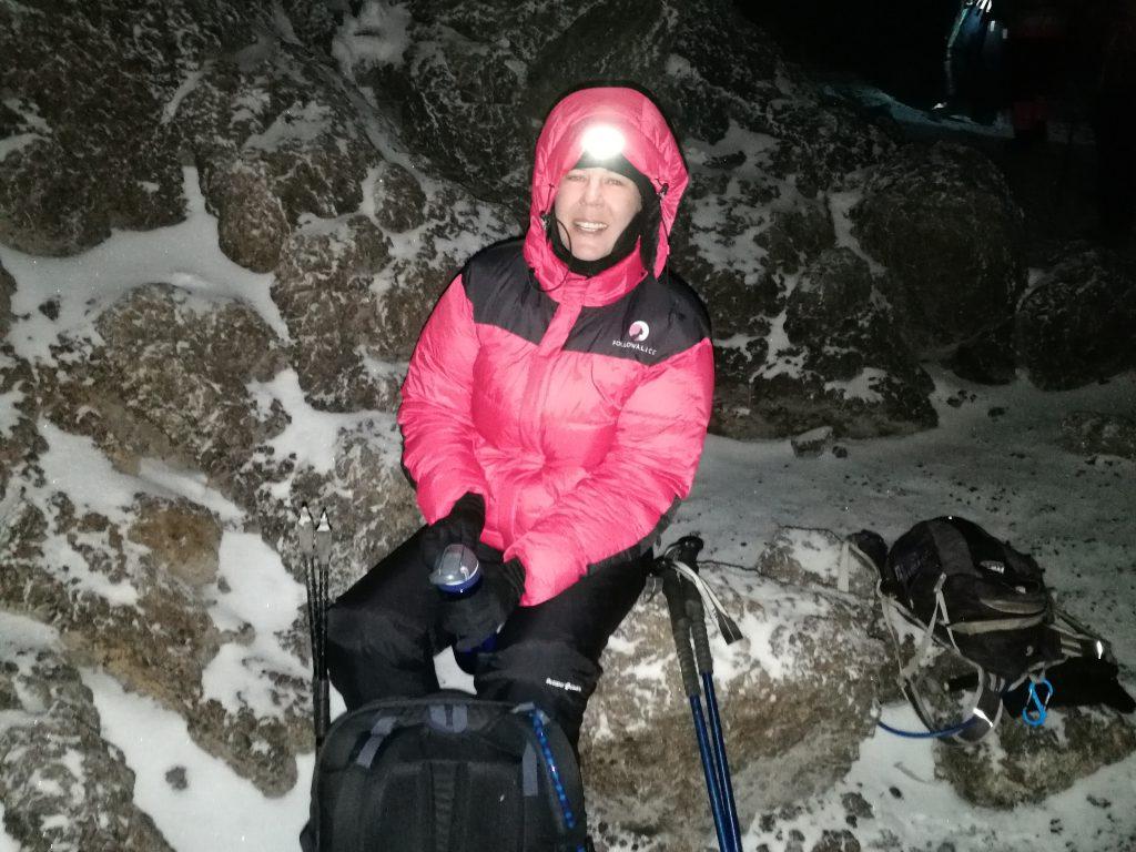 summit night smiling woman