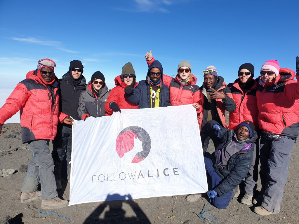 Follow Alice summit team photo Kilimanjaro