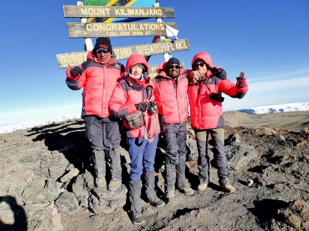 Trekkers at the summit of Mt Kilimanjaro