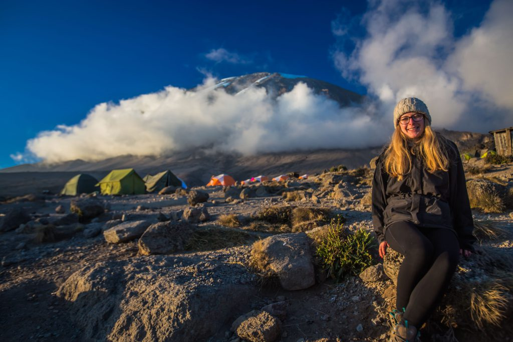 German-kilimanjaro-climber-at-the-base-camp-with-view-of-the-summit