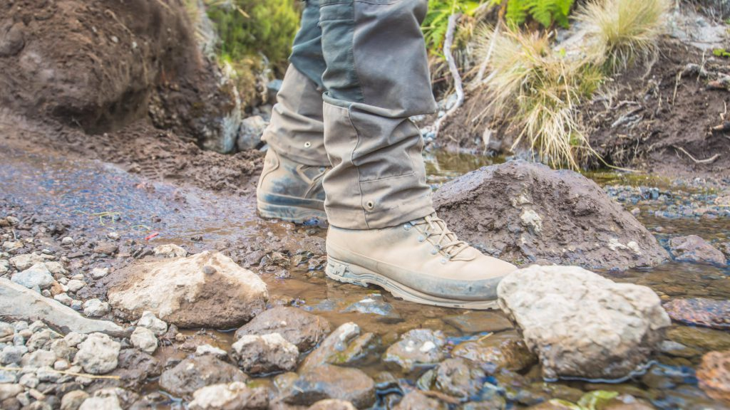 Hiking boots in a stream of water on Kilimanjaro