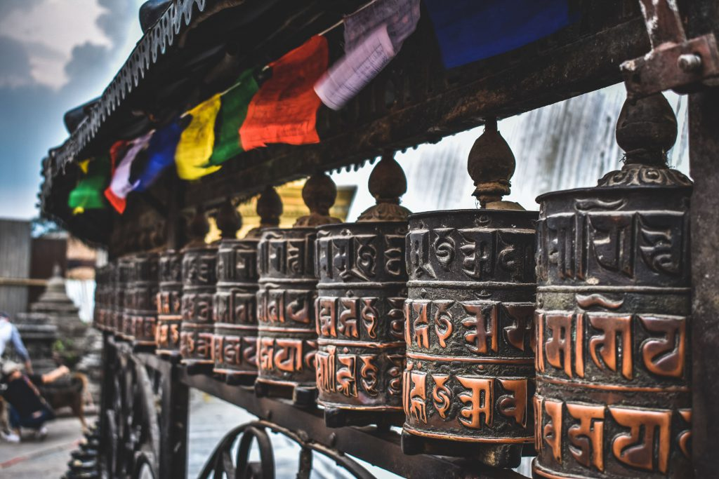 Prayer flags above Tibetan Buddhist prayer wheels