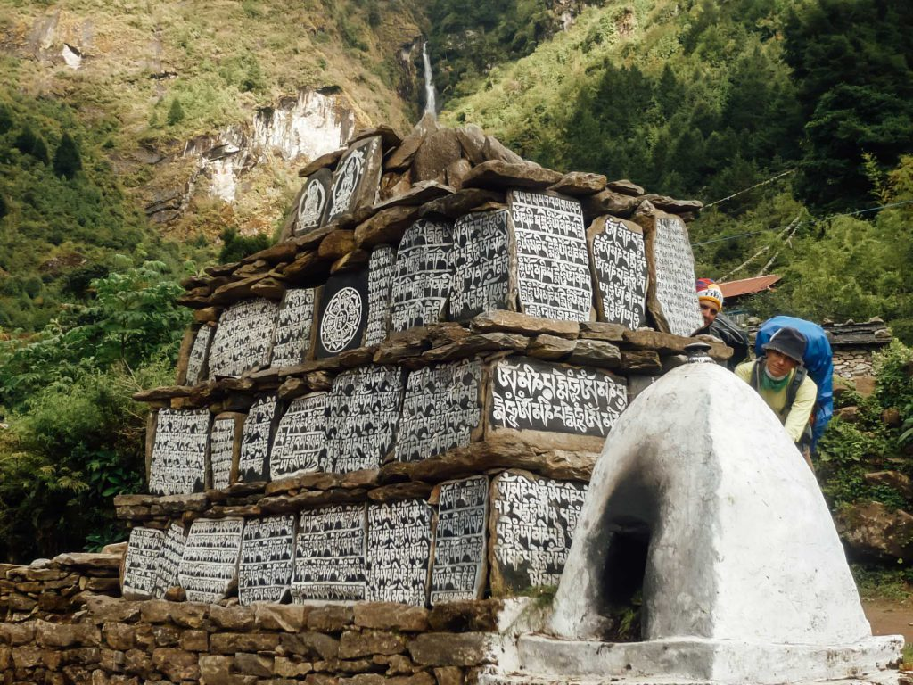 Buddhist monument near waterfall Everest Base Camp trek