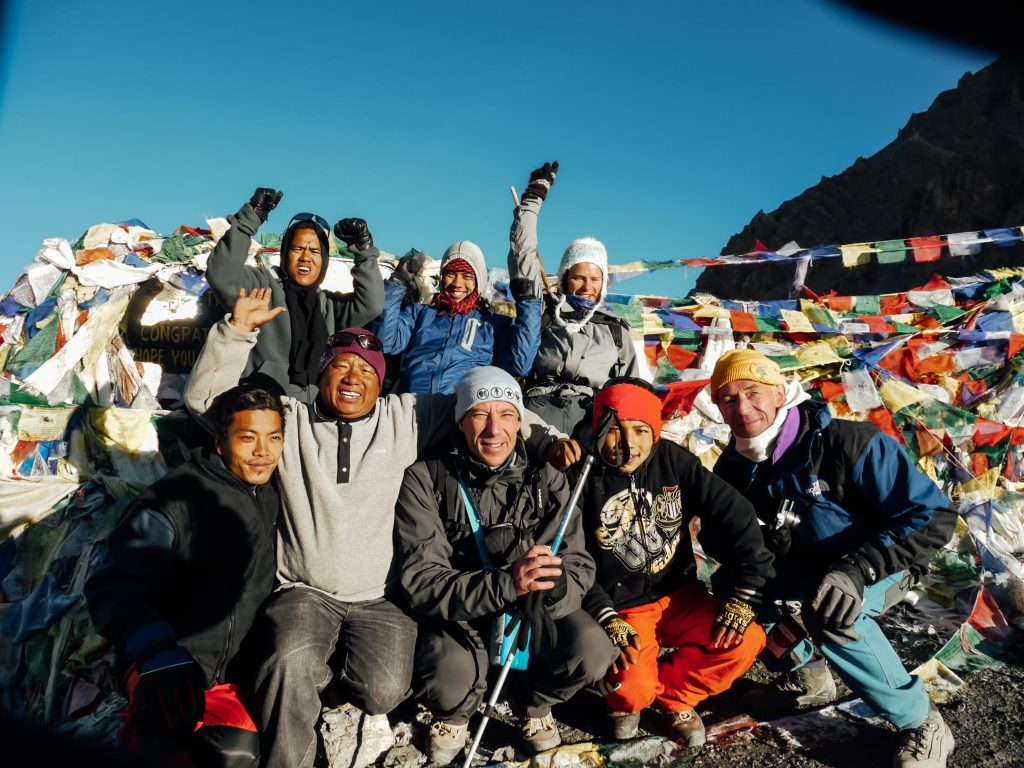 annapurna circuit group celebrating at the top of Thorung La Pass!