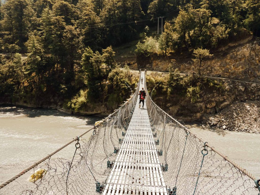 Suspension bridge across river
