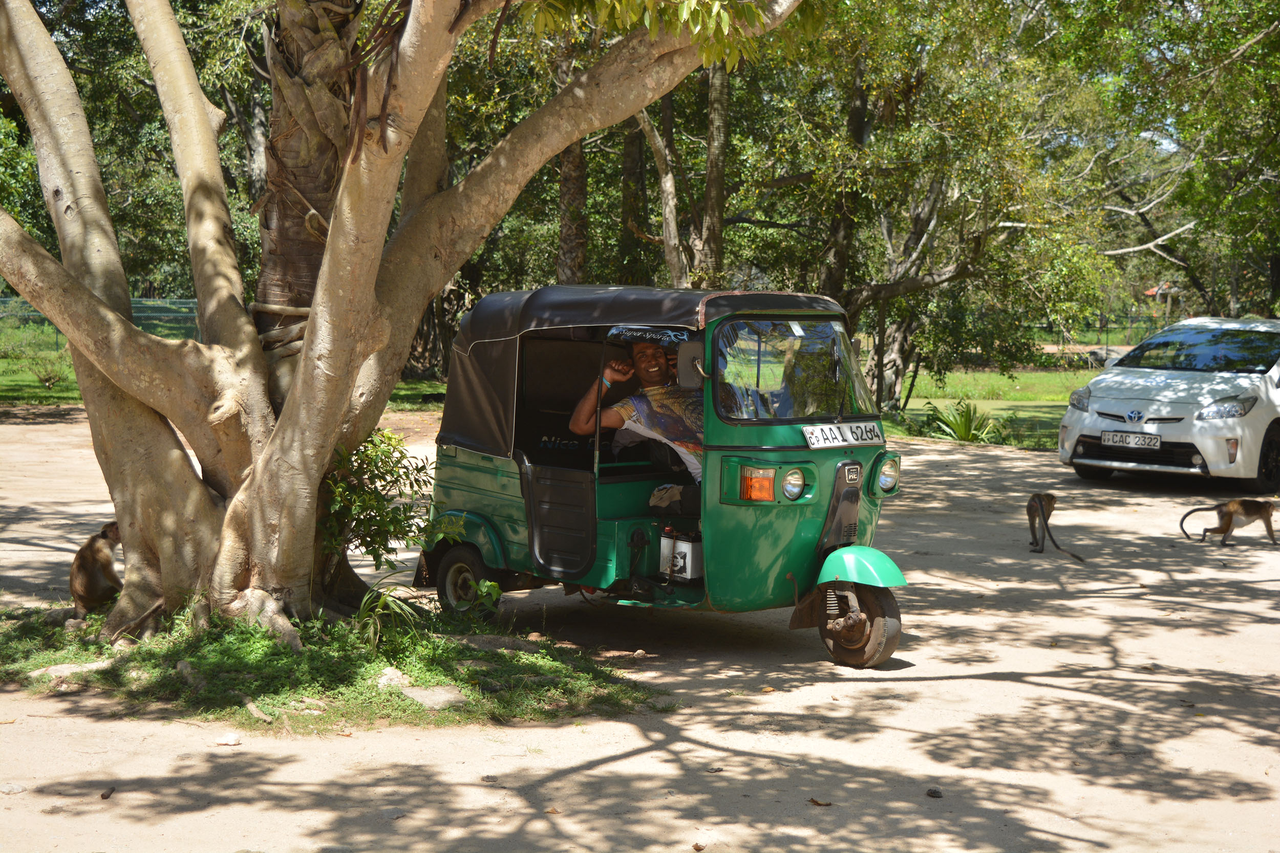 Tuk-tuk drivers carry glass water bottles