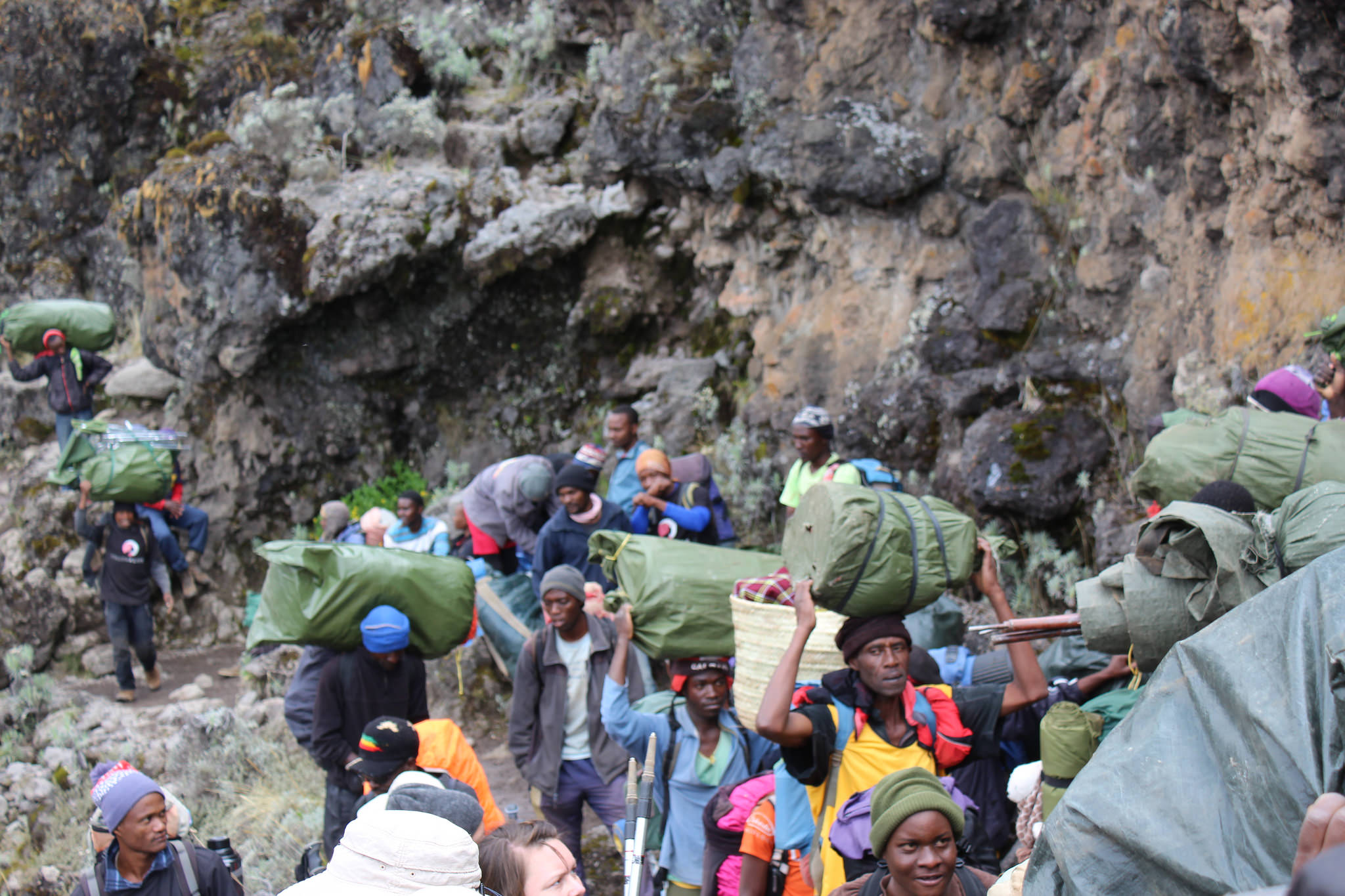 The guides and porters work hard on the mountain