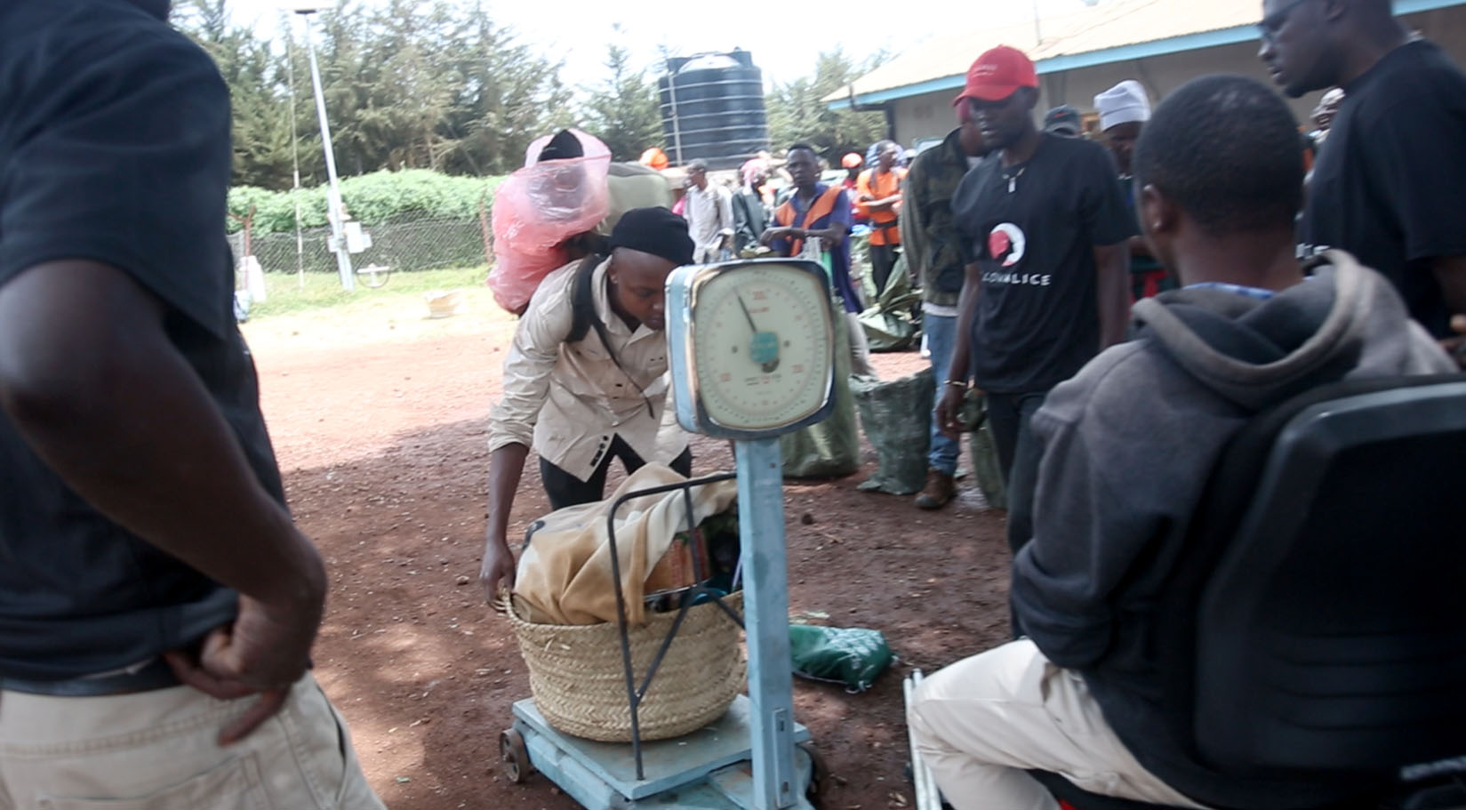 Kilimanjaro tipping porters and guides weighing their bags