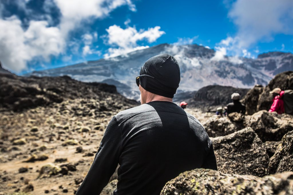 A man looking ahead at the peak of Kilimanjaro