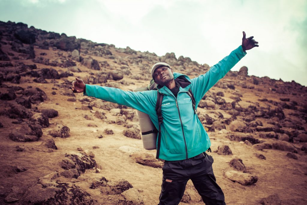 Man with open arms on mount Kilimanjaro