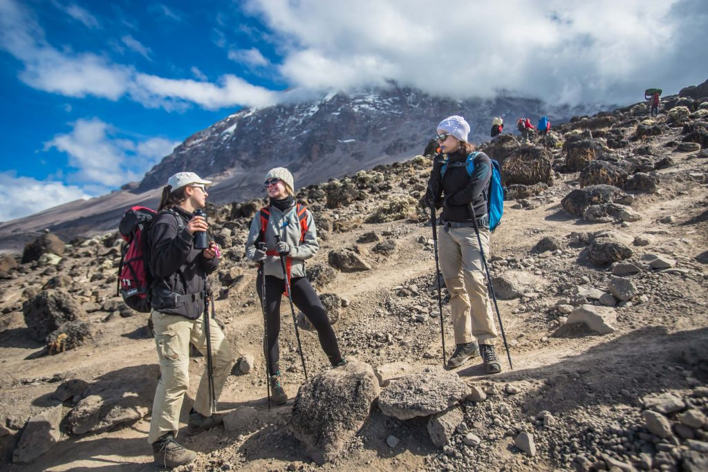 Group of people standing on Mt Kilimanjaro