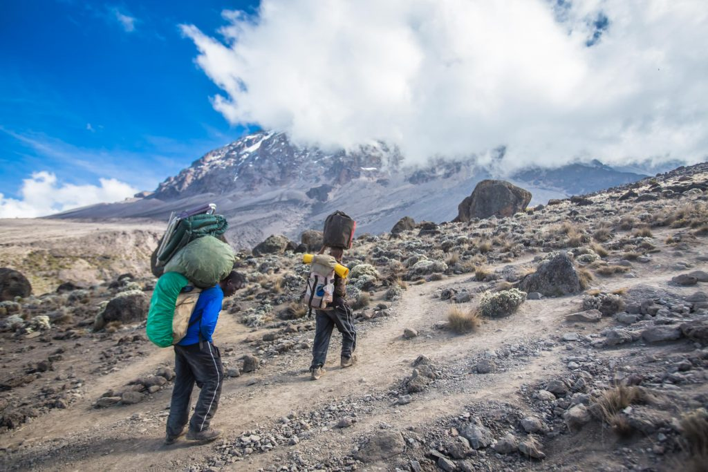 Porters carrying bags on Mount Kilimanjaro