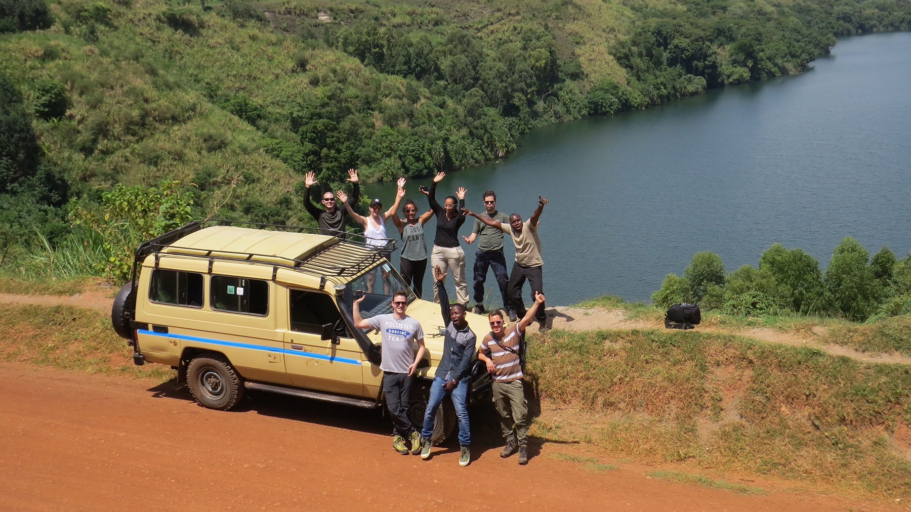 Our group posing for a photo on the road on Gorilla Trekking Uganda!