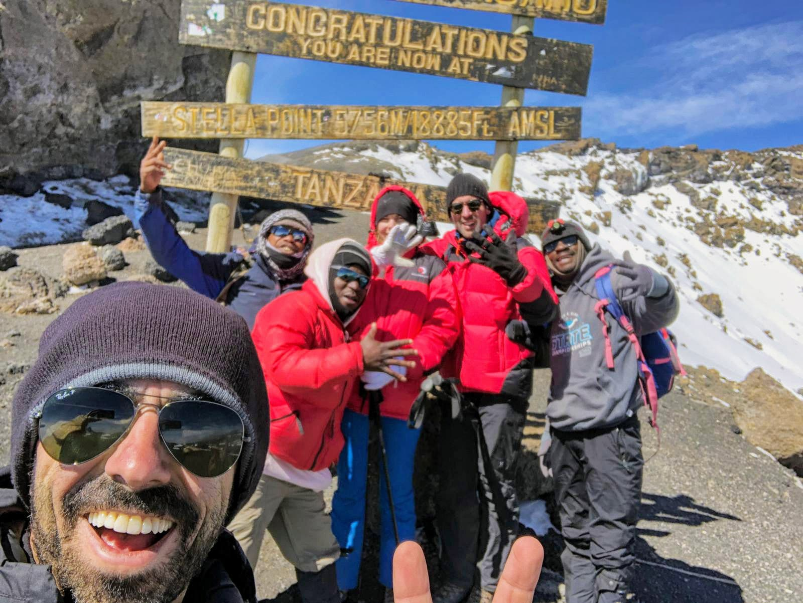 Friends smile Kilimanjaro