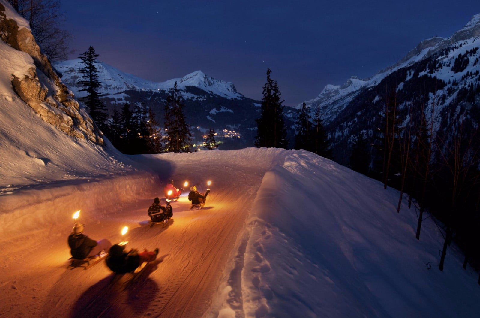 Night sledding down the mountain