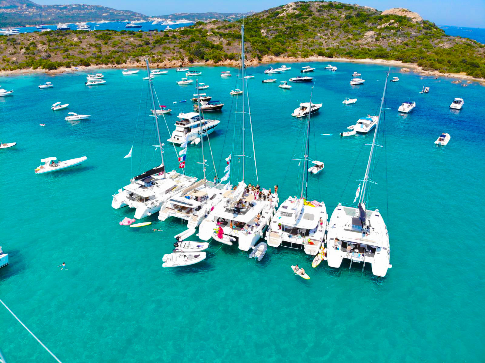 Our fleet of 5 catamarans, 60 friends!