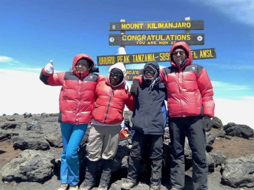 4 friends reach the summit of Kilimanjaro