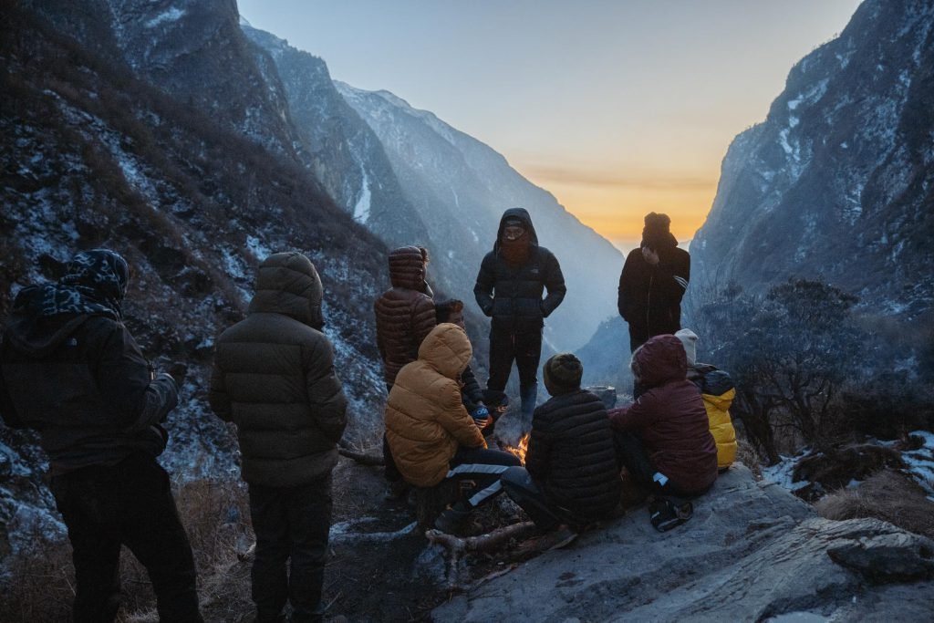 Trekkers keeping warm on Everest base camp trek