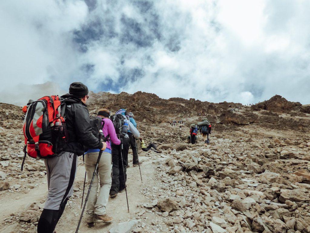 Trekkers with backpacks and trekking poles on the Everest Base Camp Trek