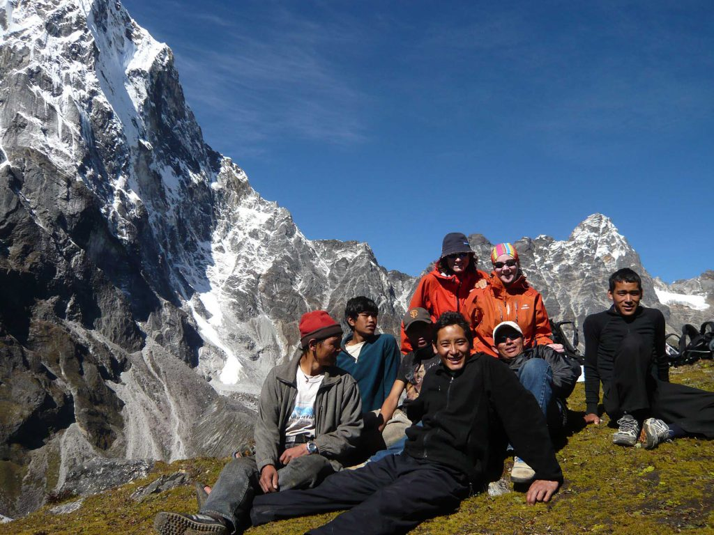 Trekkers sitting on grass on Annapurna circuit