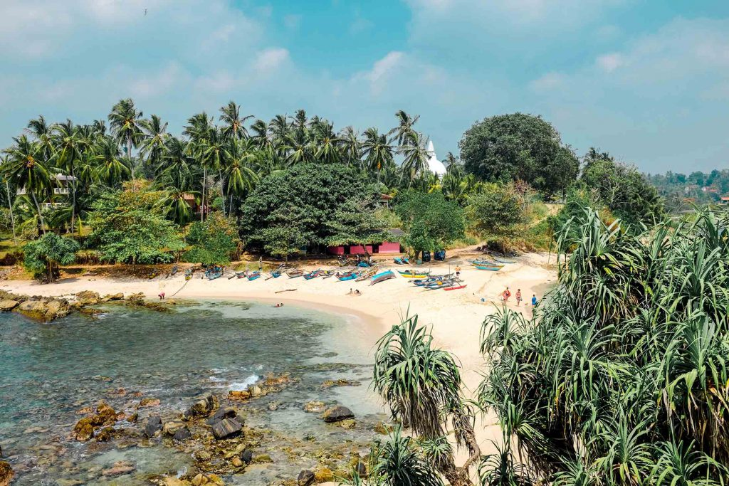 Palm trees, kayaks and white sand beach in Sri Lanka