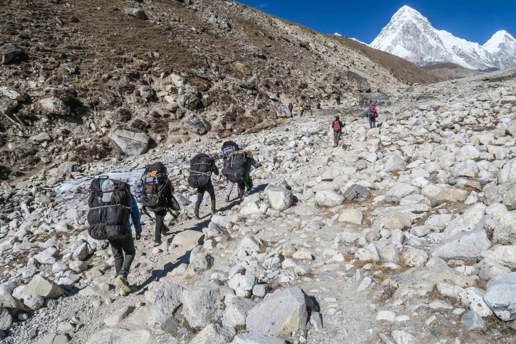 Trekkers surrounded by snow-capped peaks on the Everest Base Camp Trek