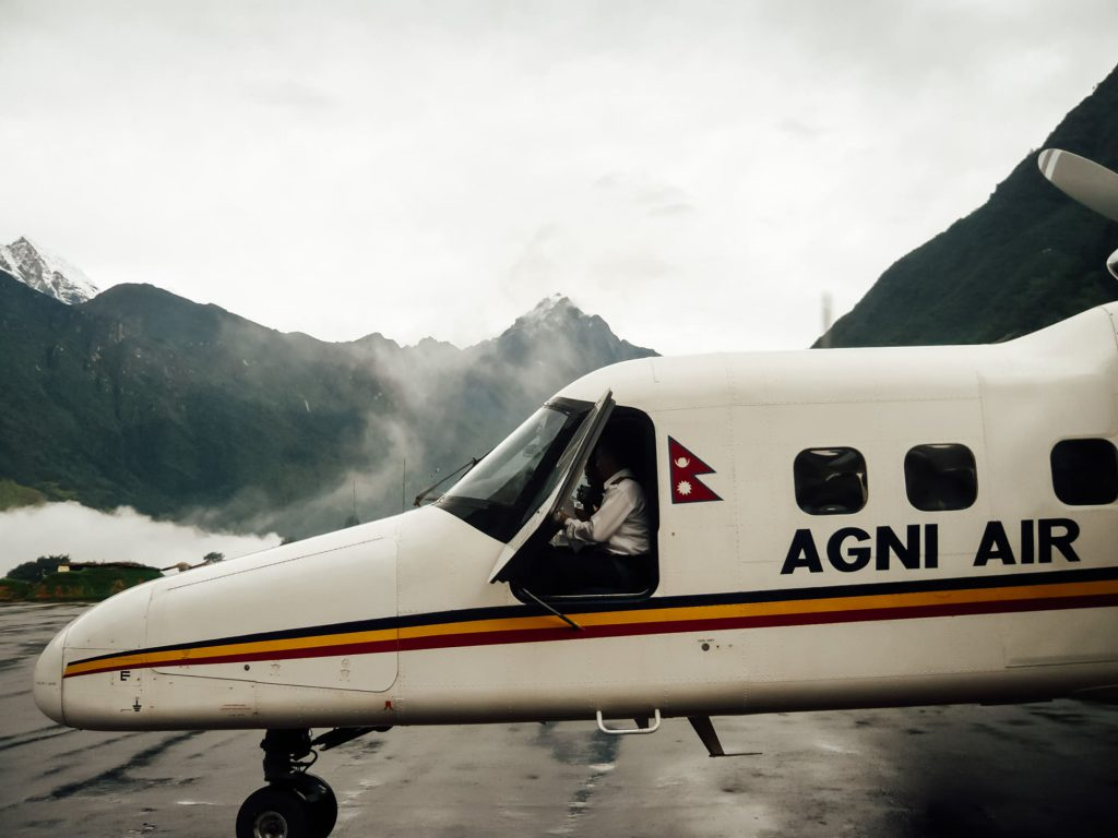 Airplane take of from lukla airport Everest Base Camp trek