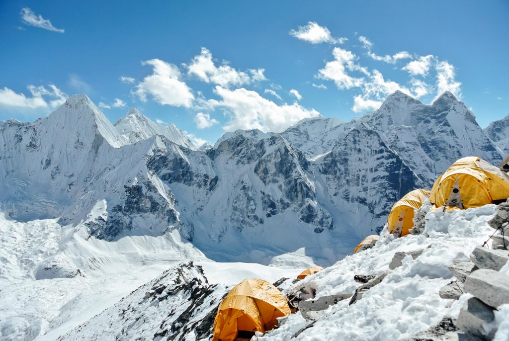 Tents in the snow covered Annapurna mountain range in Nepal