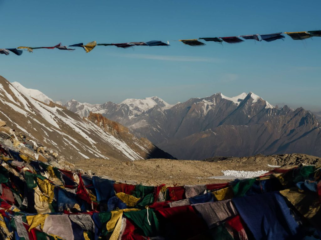 The battered state of the prayer flags attest to the ferocious winds of the Everest Base Camp trek in the Himalayas